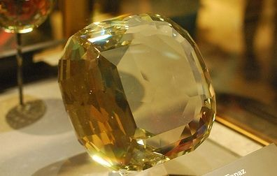 THE AMERICAN GOLDEN TOPAZ!! This is the 3rd largest faceted topaz and  perhaps the 3rd largest faceted gemstone in the world, weighing a massive 22,892.5 carats (4.5785 kg), with a cushion-cut having 172 facets. The combination of perfect cut, clarity, and color makes the gemstone one of the most renowned faceted gemstones in the world. The gemstone which is of Brazilian origin is exhibited in the Hall of Geology, Gems and Minerals of the National Museum of Natural History of the…