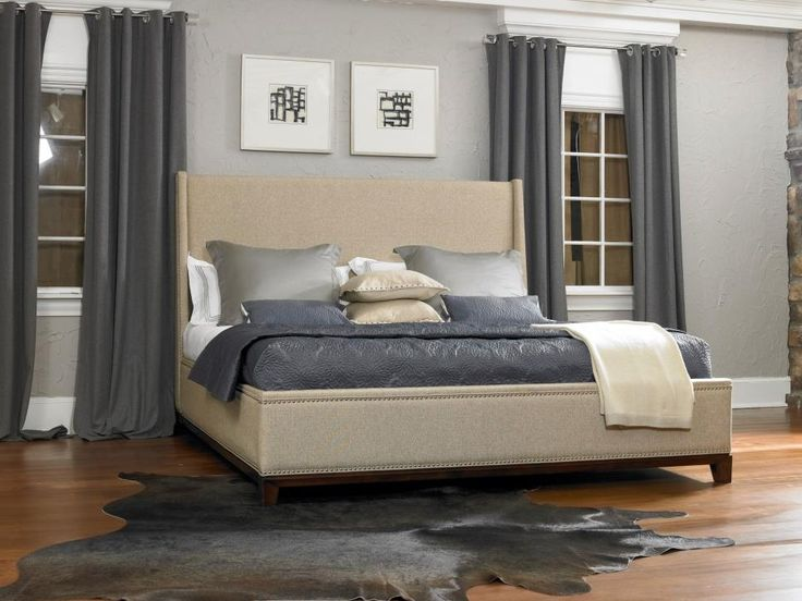 A cowhide rug brings luxury and softness to any space. They are generally seen in Southwestern-style rooms, but this silver-gray cowhide adds a contemporary look to the bedroom. The artwork, draperies and bedding pick up the silver tones of the rug for an integrated look. Photo Courtesy of Felton