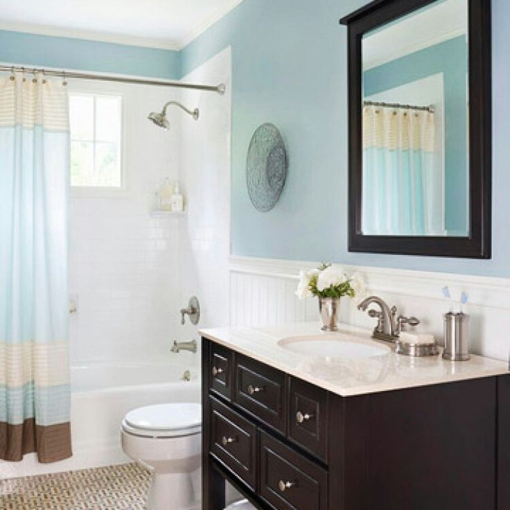 Bathrooms blue wall paint dark stain sink cabinet accent color brown and neutrals with whitetile and beadboard