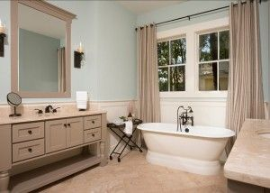 the walls are rainwash sherwin williams sw6211 and the vanities are zeus sherwin williams sw7744 beige tile bathroom