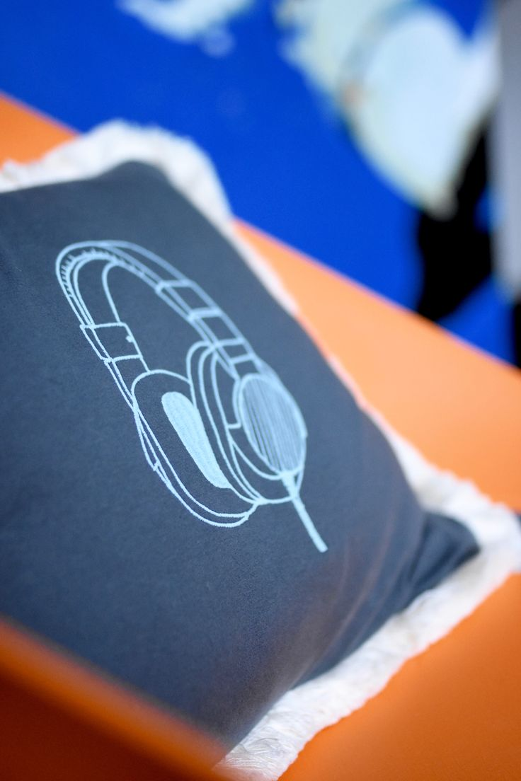 Boys room textiles. Embroidered cushion with headphones