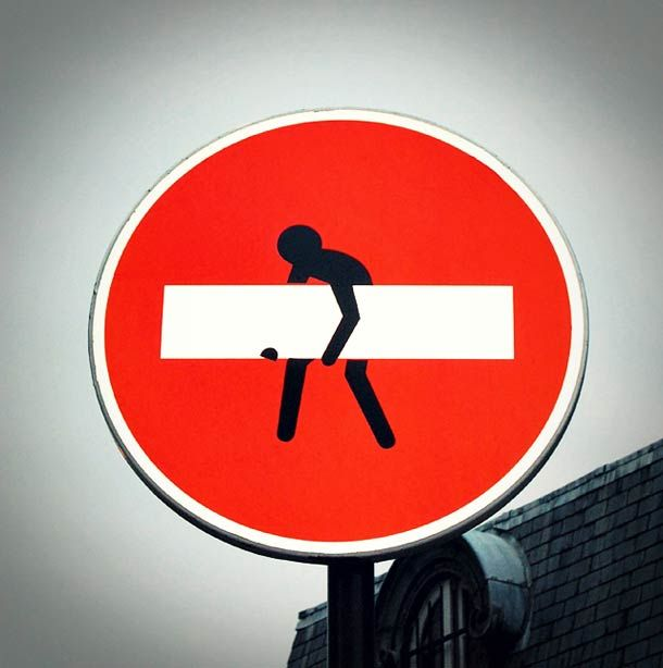 I saw this in Paris by Sacre Coeur! hijacked road signs-Clet Abraham