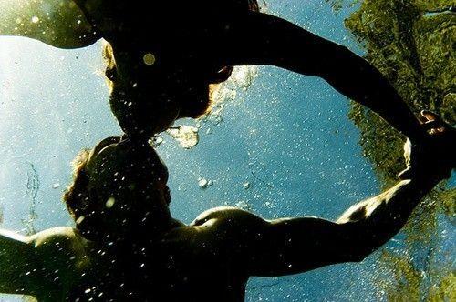 Share an underwater kiss