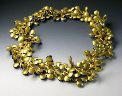 Jacqueline Ryan. 18karat gold, Vitreous enamels and garnets.