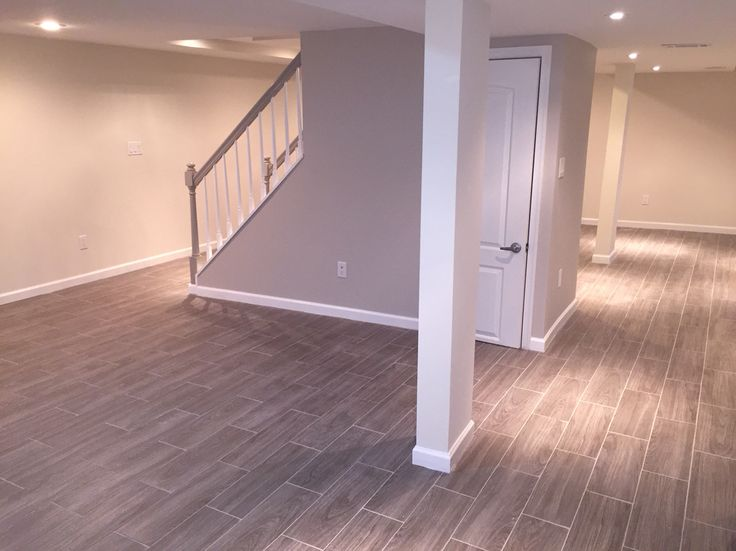 Loving my Basement!!. Modern clean Shades of grey. Grey wood tile. Sherwin Williams -paint in popular grey for staircase and Shoji White walls.