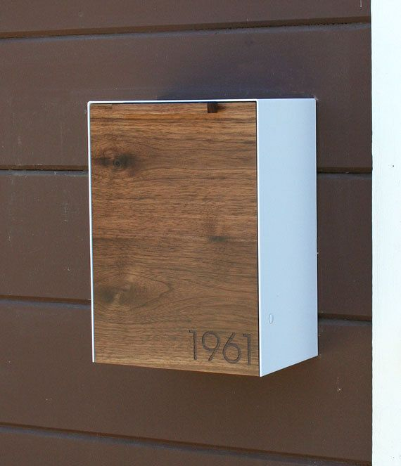 This Stainless Steel and Walnut mailbox measures 9W x12.5H x 6D. I designed this mailbox after the 1950s black mailbox that used to hang on my house. I