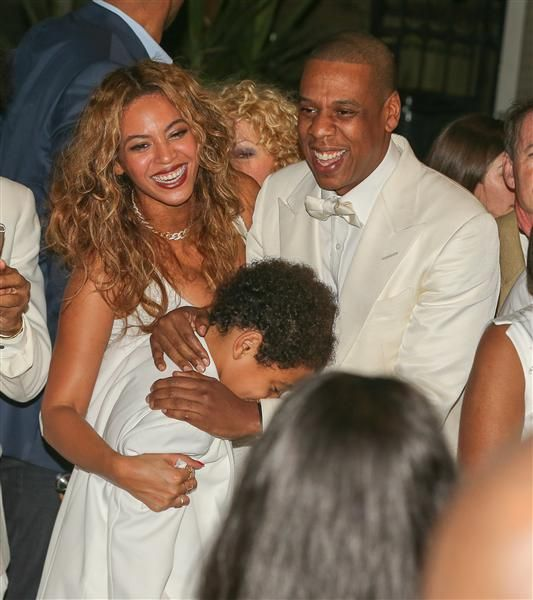 Beyonce and Jay Z share a moment with their nephew Julez Smith, Solange's son, during his mother's wedding celebration in New Orleans on Nov. 16, 2014.