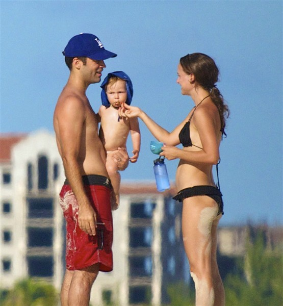 Bikini-clad Natalie Portman and husband Benjamin Millepied play on the beach with son Aleph, 2013