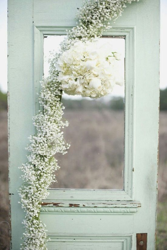 Use a vintage door as a photo booth for your wedding guests- what a creative idea!  mint green wedding.  Wedding ideas. rustic wedding.  outdoor wedding.  vintage wedding. wedding photo booth.  wedding decor.