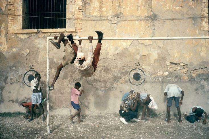 Alex Webb HAITI. Gonaives. 1994. Children playing while U.S. helicopters land.