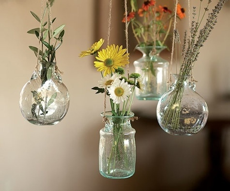 We go crazy over things that we can hang to display small botanicals in.  Find vintage bottles at antique markets and suspend them with fishing wire.