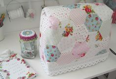 Adorable sewing machine cover!!  Love this and the fabrics!