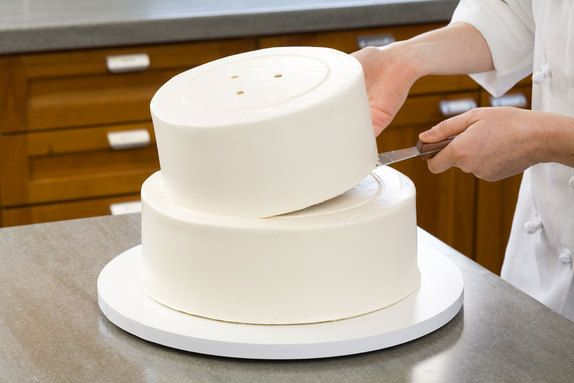 Step-by-Step instructions on making and frosting a stacked cake - this page makes it seem so DIY!!!! (Secrets to Making a Wedding Cake | The Feed)