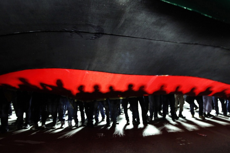 Feb. 25, 2012. People hold a giant Libyan flag during a march to Martyrs' Square in Tripoli, Libya.