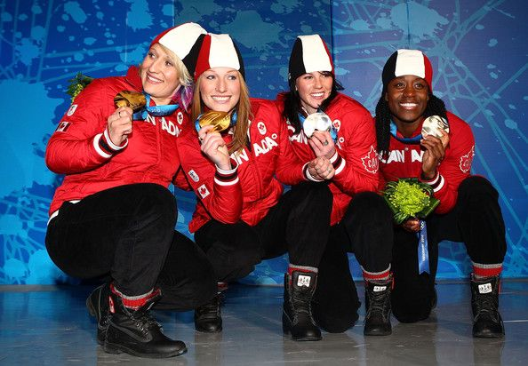 Heather Moyse Photos - (L-R) Kaillie Humphries and Heather Moyse of Canada receive the gold medal and Helen Upperton and Shelly-Ann Brown of Canada receive the silver medal during the medal ceremony for the women's bobsleigh held at the Whistler Medals Plaza ceremony on day 14 of the Vancouver 2010 Winter Olympics at Whistler Medals Plaza on February 25, 2010 in Whistler, Canada. - Whistler Medal Ceremony - Day 14