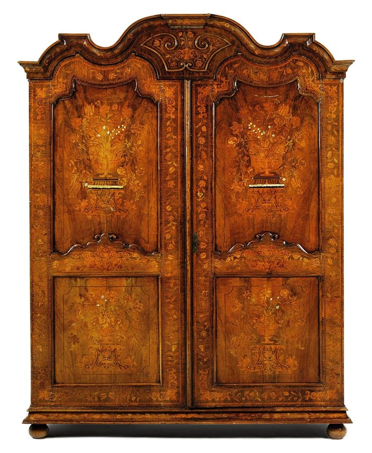 A DUTCH WALNUT, MOTHER-OF-PEARL, IVORY-INLAID AND MARQUETRY ARMOIRE - MID-18TH CENTURY,THE MARQUETRY ADDED IN THE 19TH CENTURY.