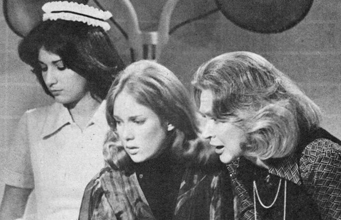 A now-grown Penny Davis (Julia Duffy, center) with Dr. Maggie Powers (Lydia Bruce) in 1976.