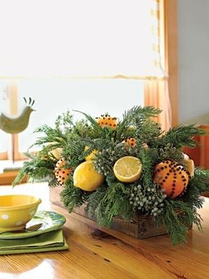 Tropical Christmas centerpiece: fresh citrus, cloves and greens. Ah the holidays!