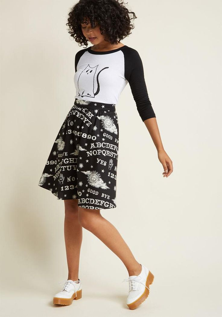 #ModCloth - #ModCloth This pocketed black skirt shows that texting is a thing of the past and mystical messages are in! Decorated with white, glow-in-the-dark ouija boards and occult-chic motifs, this cotton bottom channels otherworldly awesomeness. - AdoreWe.com