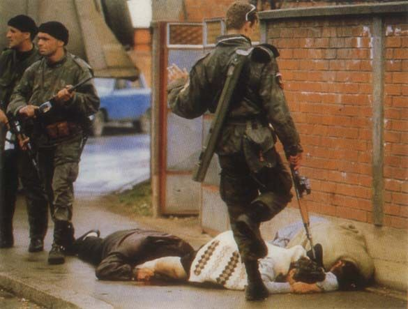 Bosnian genocide in pictures 1992-95, PHOTOGRAPHER'S CORNER [ Bosnian Genocide ] Serbian paramilitaries kick and kill Bosniak (Bosnian Muslim) civilians on the streets of Bijeljina on 31 March 1992, the first day of the Bosnian war. Serbian troops slaughtered hundreds of unarmed Bosniak (Bosnian Muslim) civilians – men, women, children and elderly – in during the attack on this norteastern Bosnian city. Photographer: Ron Haviv (Genocid u Bosni, Genocid nad Bosnjacima)