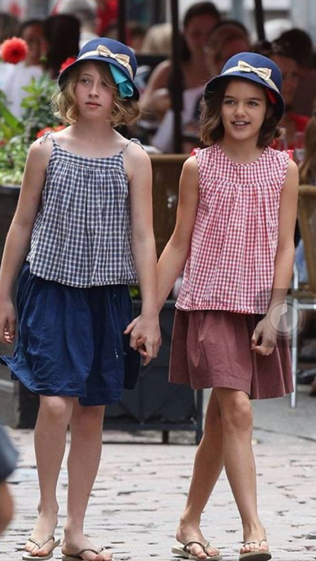 Suri and Friend walking down the street in matching ...