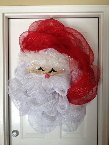 Santa Claus is coming to town. New Santa Wreath we just created from decorative mesh. Simple, Fun and inexpensive to do.                                                                                                                                                     Más