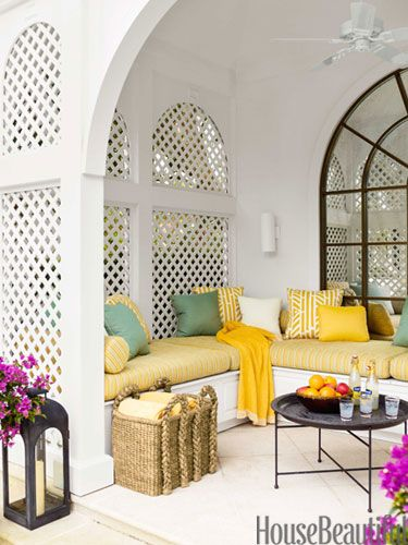 """Poolhouse ~ Carrier & Co. - The poolhouse, with cushions in Pollack's Shoreline fabric, """"was a cavern before we installed the mirror,"""" Carrier says. """"Now it reflects the light and is so inviting."""""""
