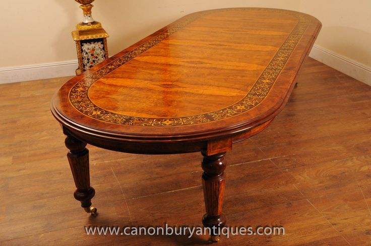http://canonburyantiques.com/s/dining-tables/victorian-dining-tables/1/  Elegant extending Victorian dining table in walnut with elegant marquetry. This Victorian table seats 10-12 when fully extended..