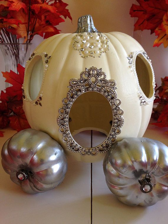 Recreate Cinderella's pumpkin carriage by using a large white pumpkin and two spray painted mini pumpkins as wheels.
