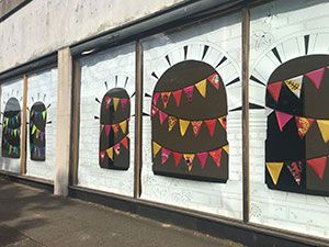 Bunting designs in vacant shop windows on Tower Way