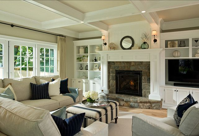 The custom trim work in this family room are what elevates it from standard builder fare: a wall of handsome built-ins flanking a stone fireplace; a coffered ceiling, crown molding. Delightful.