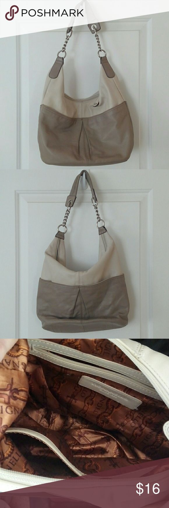 Tiganello Neutral purse Tiganello shoulder bag, kind of like a hobo. Roomy, lightweight,  strap with silver chain details and soft shoulder strap, drop is 11in. Exterior is 14x 4.5x 9 in, with four exterior pockets. Interior clean with 3 pockets,one is zippered. Great two tone neutral colors. Used but good condition.  Genuine leather. Tignanello Bags Shoulder Bags