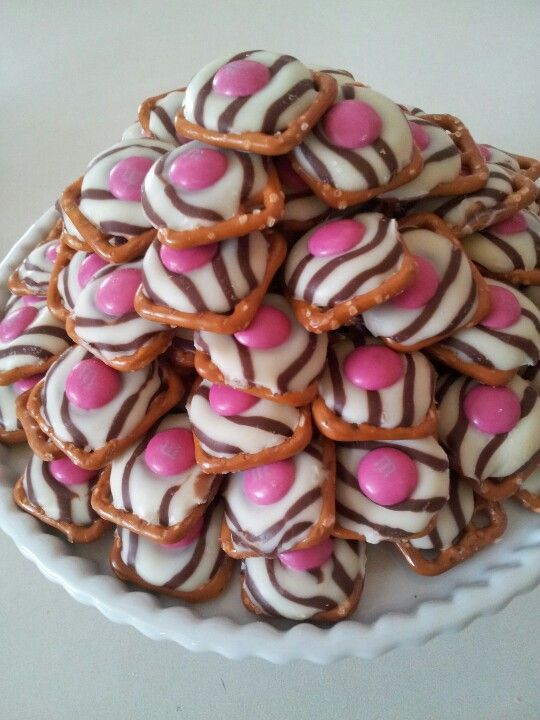 Pretzel Hugs with pink MM's! The perfect Pink Zebra Party snack! ;)  All you need is a square pretzel, a Hershey Hug, and a M and M. Bake in the oven at 200°F for 3-4 minutes.http://pinterest.com/pin/150729918750699547/