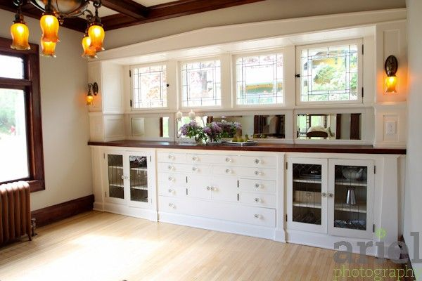 Great space! Love the windows. Warm light fixtures.  Also, once again the mix of painted and stained woodwork.
