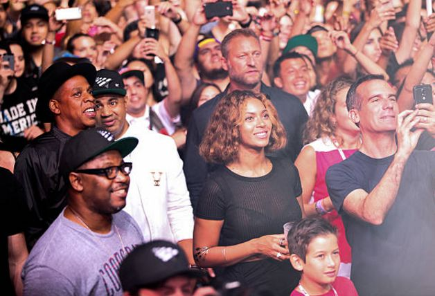 "Jay Z, Lenny ""KodakLens"" Santiago, Emory ""Vegas"" Jones, Beyoncé and Los Angeles mayor Eric Garcetti, photographed in the crowd during Steve Aoki's set at day two of the LA ""Made in America"" festival, on August 31, 2014."