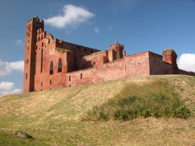 Radzyn Castle... is located in Radzyn Chelminski, Poland.  It was a Teutonic Knights' castle. Its red brick walls and size make it reminiscent of Malbork Castle.
