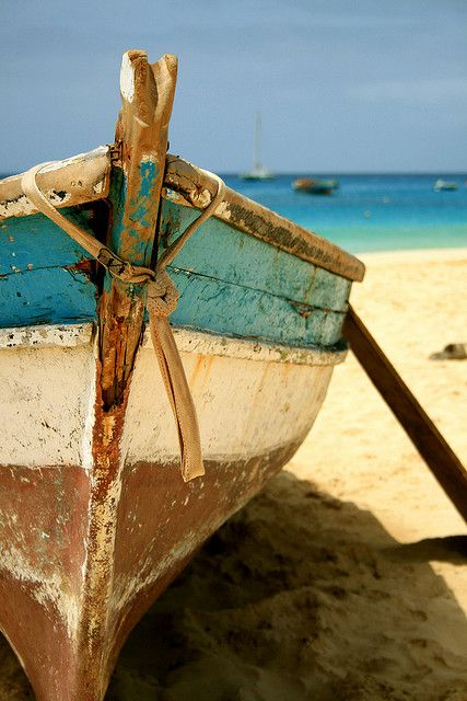 love the boat on the beach near the azure colored sea