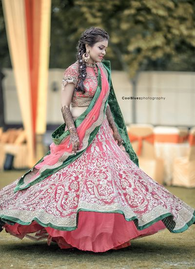 Mehendi Outfits - Coral and Green Lehenga | WedMeGood | Coral Lehenga with all over Silver Threadwork Embroidery and Green Border Detailing, Coral Blouse with Cutwork on Sleeves  #wedmegood #mehendioutfit #sisterofthebride #coral #green #indianbride #indianwedding