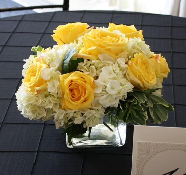 Yellow wedding flower centerpieces with