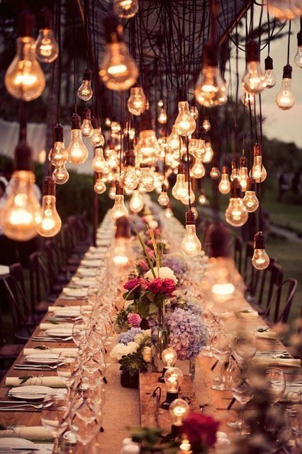 """How to create the most """"romantic wedding ever"""" with stringed Edison bulbs and plenty of candles."""