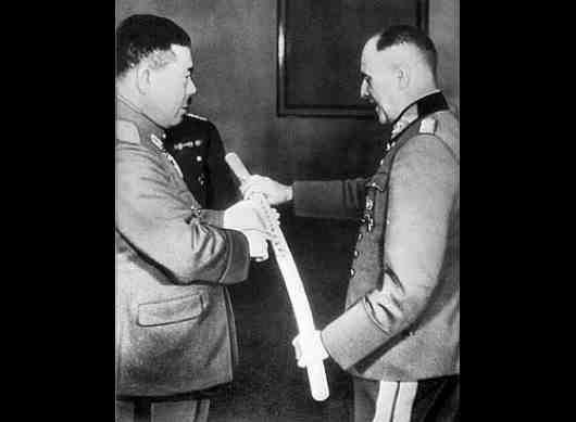 Japanese General Tomoyuki Yamashita, translates the inscription on a samurai sword for German Field Marshal Walter von Brauchitsch in Berlin in 1941