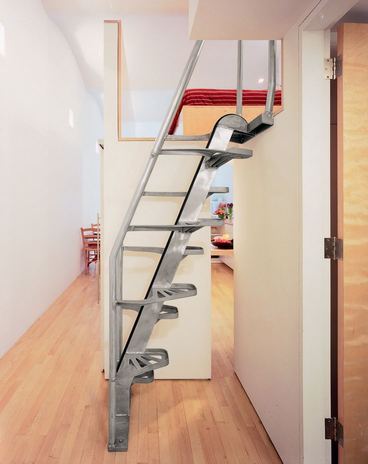 """""""The stair [by Lapeyre Stair] is very cost-effective, as compared to building woodwork,"""" Woo explains. """"It occupies very little space, and you can come down without holding the rail."""" Of the small gap that reveals the kitchen, he says, """"That's very important, to give a sense of continuous space."""""""