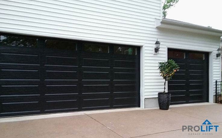 Black Garage Doors With Long Windows In 2020 Garage Door Colors Black Garage Doors Garage Doors