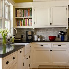 craftsman kitchen by FGY Architects, notice bookshelf in corner that would be difficult to reach as cabinets