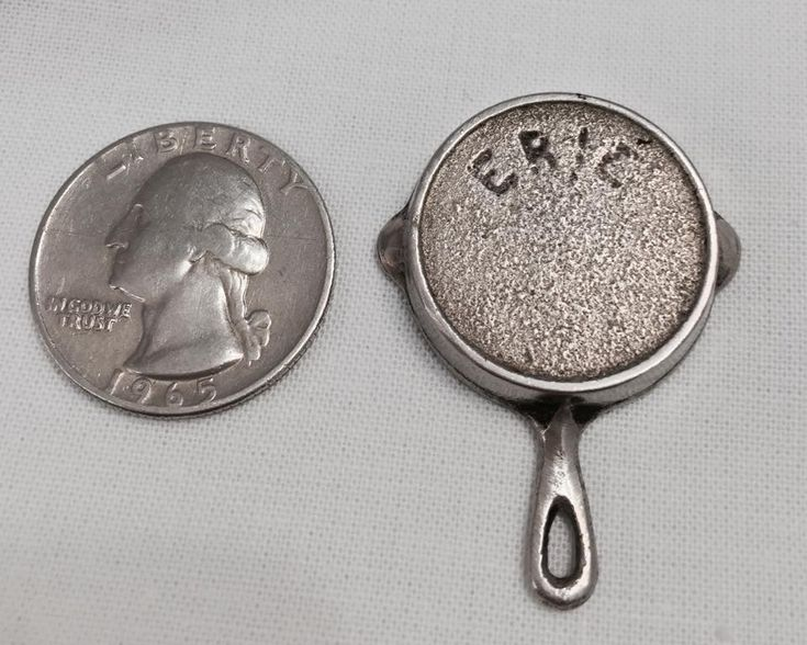 This belonged to Nick DiRienzo's estate. It was purchased by Lori Lewis Zaumseil at auction. He was a HUGE and very serious Griswold collector.  He bought the piece from Joanie Baldini --she is one of the original founding members of GCICA.    She said that this is actually a watch fob (as Nick had written on the envelop it was in).  These were made for the salesmen, back in the days when every salesman wore a nice suit and carried a watch on a chain!