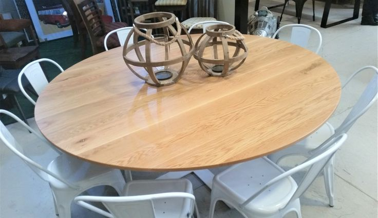 Round American Oat Timber designer table, 1800 mm diameter.   Although you can't see it in this picture, this table has a beautiful crossed base which adds a great detail and something a little bit different. Unique and beautiful!  Check out our website or come in to our showroom in Nunawading for more beautiful furniture to add to your home!