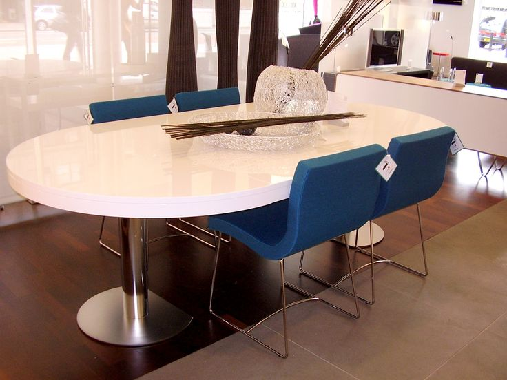 The Craft 1 by Delo Lindo 2001. This extending dining table is available in Walnut Veneer or White, Argile, Elephant lacquer. It two pedestals separate to accommodate two 60cm extension pieces. The extension piece are especially construction to complete the tables fringe and thus must be stored outside of the table. H74 x 130dia/ 250cm.