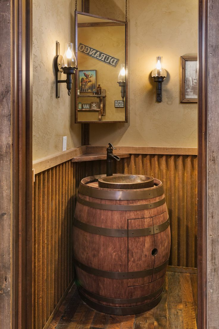 Traditional Mountain Rustic custom home with an old oak barrel sink and corrugated metal siding accents in this bathroom designed by Kogan Builders, Inc. of Durango, CO