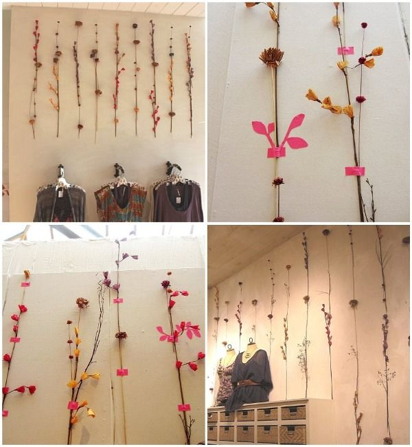 Love the pink tape used to hang all the beautiful wood and flowers on this wall <3