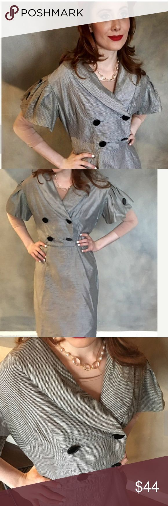 """Grey vintage dress This dress's double-breasted button placket, bell sleeves and round lapel give off serious fifties trophy wife vibes. Tag says 'ladies worker union,' proving it's genuine. Small rip under arm and inside of collar. Fabric unmarked. Measures 19"""" pit to pit, 14"""" across waist and 36"""" long. Vintage  Dresses Midi"""